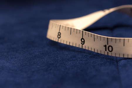 Photo pour Tailor's White Tape Measure on Dark Blue Velvet Cloth - image libre de droit