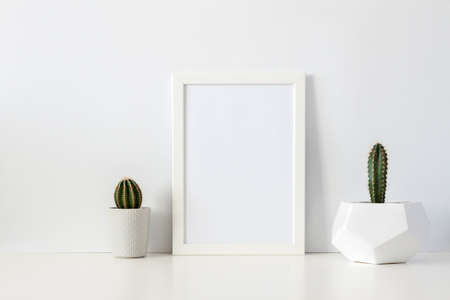 Photo for Two cactuses in pots against a white empty wall. Mockup frame. Geometric flower pot. White shelf at home. - Royalty Free Image