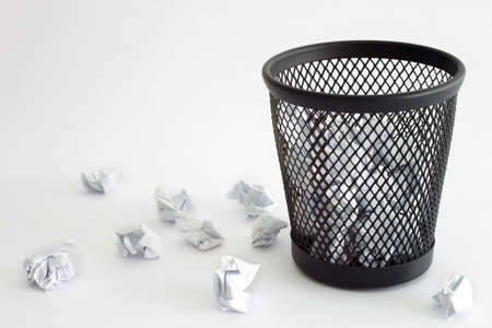Trash bin and paper - office concept