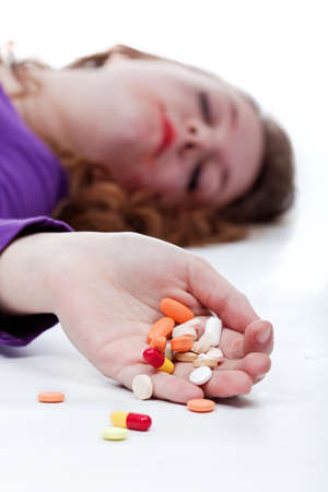 Teenager girl suicide with drug pills - isolated