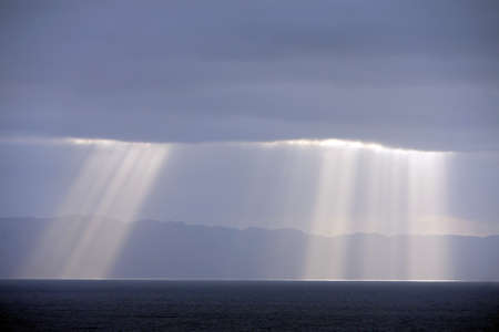 rays sun breaking through the clouds before Porto Santo, Canico, Madeira, Portugal