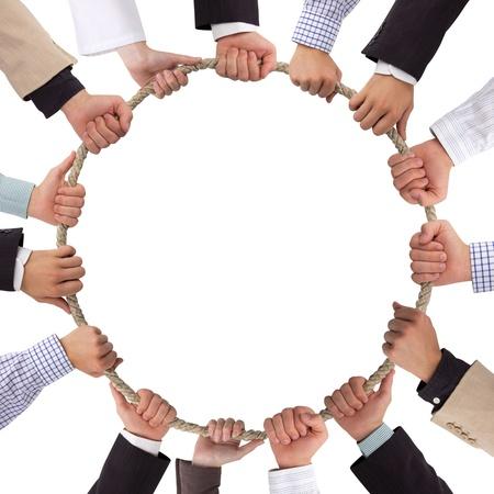 Photo pour Hands holding rope forming a circle - image libre de droit
