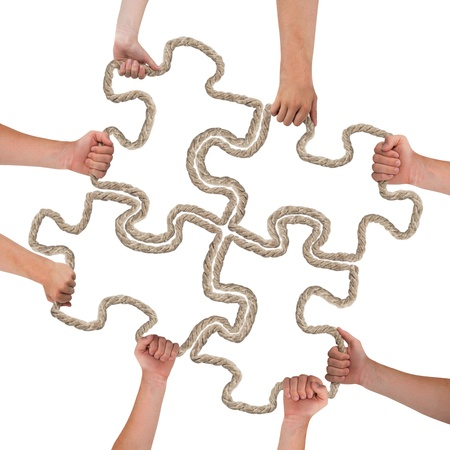 Hands holding puzzle isolated on white