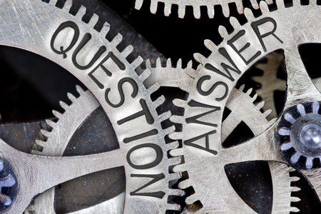 Photo pour Macro photo of tooth wheel mechanism with imprinted QUESTION, ANSWER concept words - image libre de droit