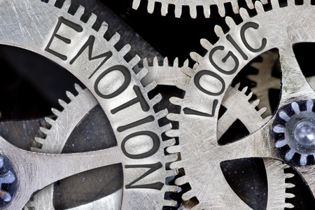 Photo for Macro photo of tooth wheel mechanism with imprinted EMOTION, LOGIC concept words - Royalty Free Image