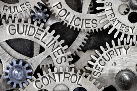 Photo pour Macro photo of tooth wheel mechanism with GUIDELINES, CONTROL, POLICIES, SECURITY, STRATEGY and RULES concept words - image libre de droit