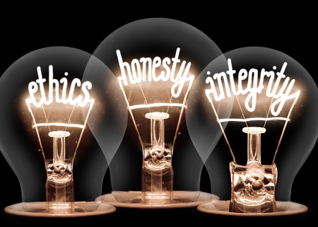 Foto de Photo of light bulbs with shining fibres in ETHICS, HONESTY and INTEGRITY shape isolated on black background - Imagen libre de derechos