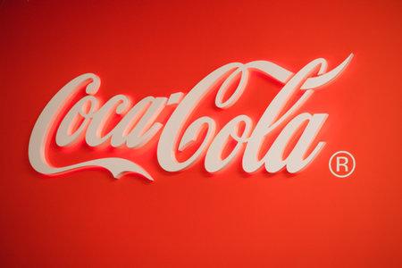 Photo pour Samara Russia- 04.30.2019: Glowing Coca Cola logo. Coca Cola stamp on a red background. - image libre de droit