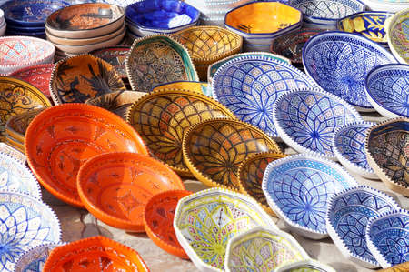 Ceramic decorated plates from Tunisia painted with various colors