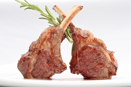 Lamb lion with thyme elegantly served on a white background isolated