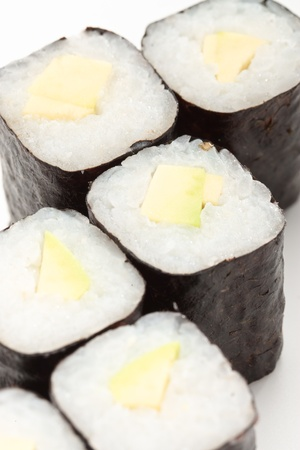 Close-up of maki sushi rolls with avocado isolated