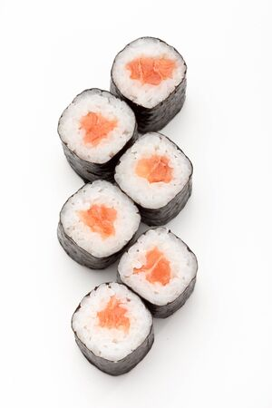 Close-up of maki sushi rolls with salmon isolated on a white background