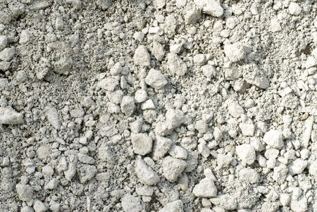 Extreme detail of gravel and broken concrete.