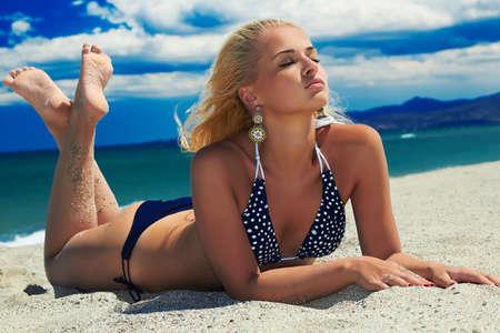 beautiful sexy woman on the beach. beauty Blond girl in bikini. summer holidays.Blue Sea