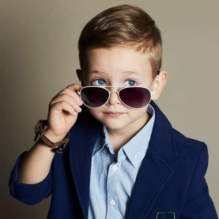 fashionable little boy in sunglasses.stylish kid in suit. fashion children.business boy