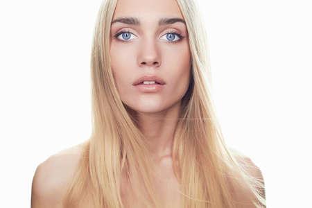 Foto de beautiful young woman with long hair on white background.Blonde girl.flying hair - Imagen libre de derechos