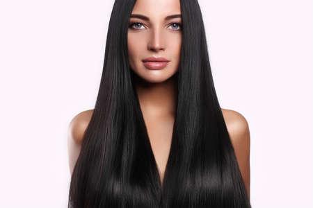 Foto de beautiful woman with long hair and make-up.beauty model girl with shining hair - Imagen libre de derechos