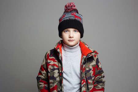 Foto de portrait of Fashionable Boy in winter outerwear. fashion kid. child. stylish teenager in hat - Imagen libre de derechos