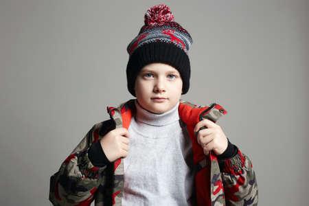 Foto de portrait of Fashionable Boy in winter outerwear. fashion kid. child. stylish teenager in hat and ski jacket - Imagen libre de derechos
