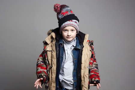 Foto de Funny Boy in winter outerwear. fashion kid. child. teenager wore all his clothes - Imagen libre de derechos