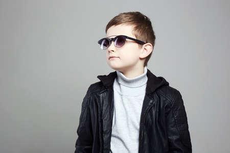 Foto de fashionable little boy in sunglasses. stylish kid in leather. fashion children - Imagen libre de derechos