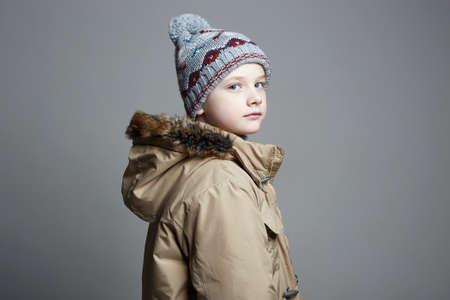 Foto de Fashionable Boy in winter outerwear. fashion kid. child. stylish teenager in knitted hat - Imagen libre de derechos