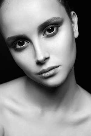 Photo pour Female Face. beautiful girl with big eyes. young woman with clean skin face. Beauty Fashion black and white Portrait - image libre de droit