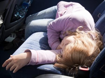 Little girl, sleeping in the bus