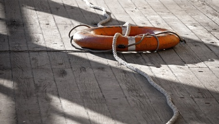 Lifebuoy with rope on the naval deck