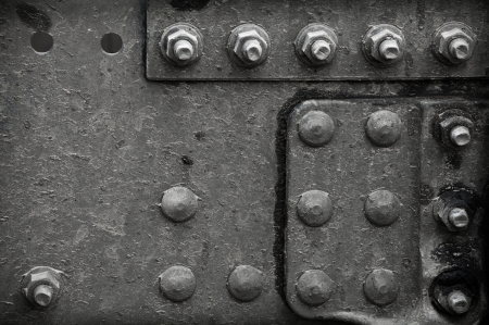 Industrial abstract background texture with black steel structure with bolts and rivets