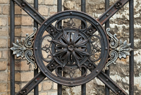 Vintage forged decorative element on metal gate in old part of Tallinn, Estonia