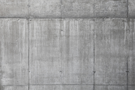 Background texture of modern gray concrete wall made of blocks