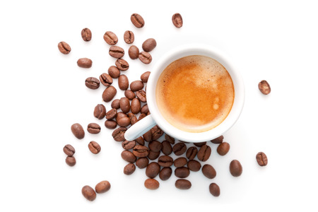 Small espresso cup with coffee beans isolated on white background