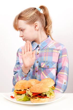 Little blond Caucasian girl saying hamburgers  No