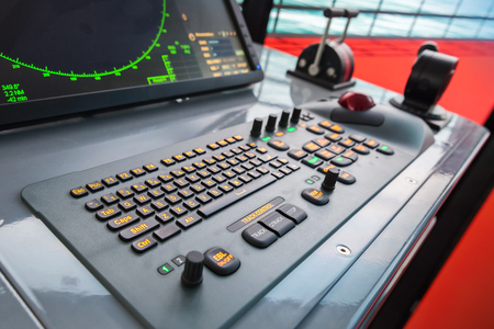 Modern ship control panel with radar screen, accelerator, trackball and keyboard