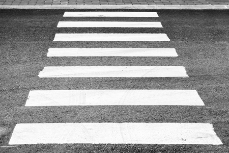 Photo for Pedestrian crossing road marking, white rectangles over gray asphalt pavement, perspective view with shallow DOF - Royalty Free Image