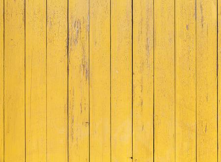 Foto de Old yellow wooden wall with cracked paint layer, detailed background photo texture - Imagen libre de derechos