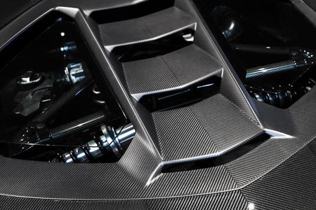 Photo pour Luxury Italian sports car fragment, rear aerodynamics carbon spoiler covers engine compartment - image libre de droit