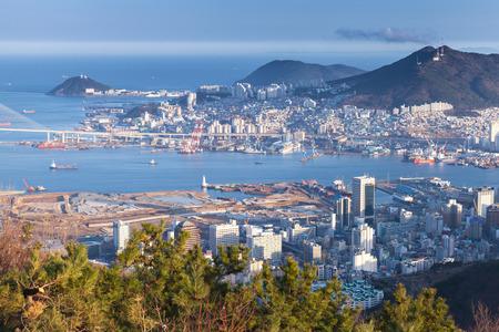 Photo pour Busan city, South Korea. Aerial view with coastal buildings and ships - image libre de droit