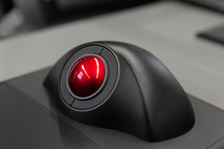 Photo for Industrial control panel with red trackball, close up photo with soft selective focus - Royalty Free Image