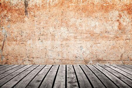 Foto de Empty interior background with grungy yellow concrete wall and dark wooden floor, abstract photo texture - Imagen libre de derechos