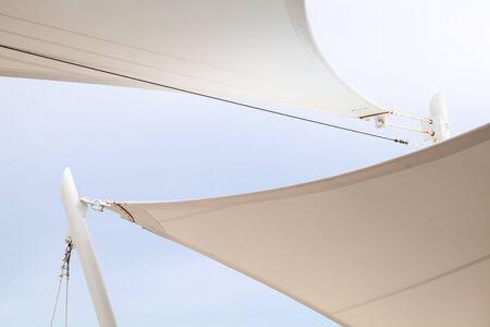Photo pour White awnings in sails shape under bright blue sky background - image libre de droit