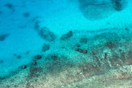 Photo pour Persian Gulf, rocky seabed is under blue shallow water. Natural photo. Bird eye view - image libre de droit