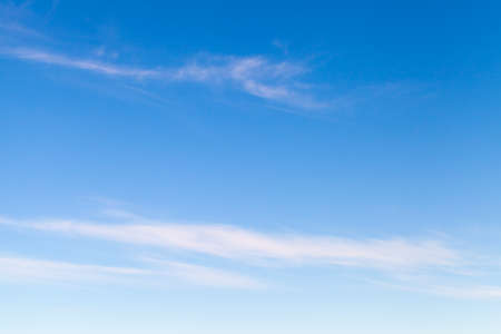 Photo pour Blue sky with windy thin clouds at daytime, natural background photo texture - image libre de droit