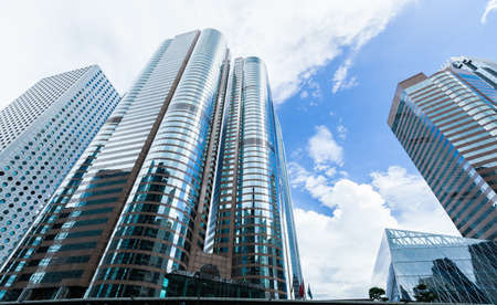 Photo for Urban skyline with perspective view of modern commercial skyscrapers, high-rise office buildings in Hong Kong city - Royalty Free Image