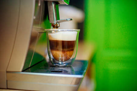 Photo pour Close-up of espresso pouring from coffee machine. Professional coffee brewing - image libre de droit