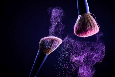 Photo for Makeup brush with pink on the black background. Face - Royalty Free Image