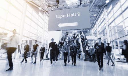 Foto de blurred people at a trade fair hall - Imagen libre de derechos