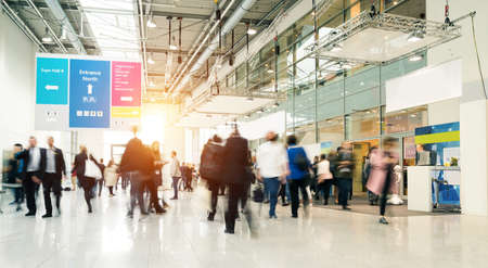 Photo pour blurred people in a modern hall - image libre de droit