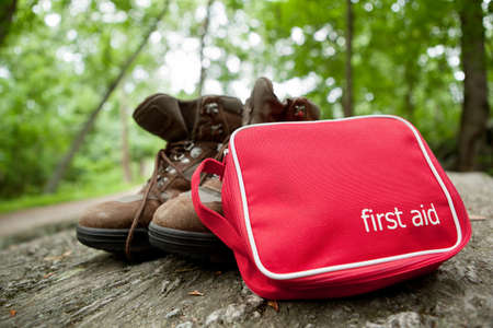 First aid kit and hiking boots